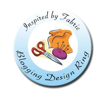 Fabri-Quilt design team button